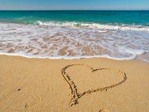 Heart on the sand of a beach. Stock Photos