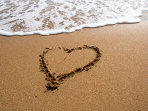 Heart on the sand beach. Sign heart on the sand beach Stock Photos