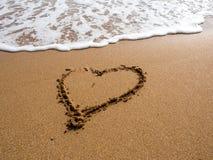 Heart on the sand beach. Stock Photos