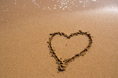 Heart on the sand beach. Sign Heart on the sand beach Stock Photo