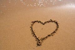 Heart on the sand beach. Stock Photo