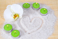 Heart sand candle orchid Royalty Free Stock Photo