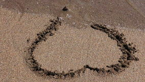 Heart on the sand stock footage
