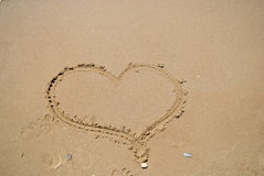 Heart in the sand. Heart drawn in the sand Stock Images