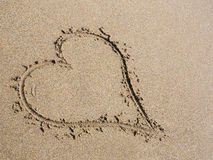 Heart in sand. Heart drawn in the sand. Beach background Stock Image