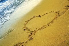 Heart on sand. Heart on the sand, on a hot summer day Royalty Free Stock Photo