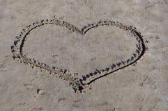 Heart on sand stock image