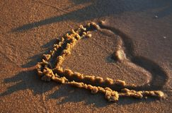 Heart on sand Stock Photography