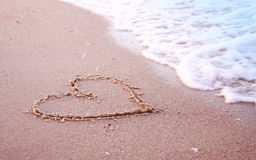 Heart in the sand on the seashore Stock Photography