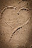Heart in sand. A heart shape drwan in wet sand Stock Photo