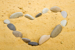 Heart into a sand Stock Photography
