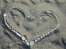 Heart on sand from stones Royalty Free Stock Images