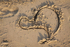A heart in the sand on sunset Stock Images