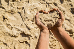 Heart from sand Stock Image