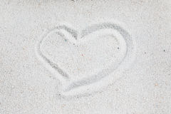 Heart on the sand. Heart symbol sand valentine romantic love background Stock Photography