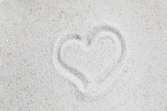 Heart on the sand. Heart symbol sand valentine romantic love background Stock Images