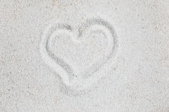 Heart on the sand. Heart symbol sand valentine romantic love background Royalty Free Stock Photo