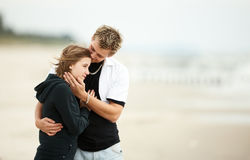 Heart on the sand two young lovers kissing Royalty Free Stock Photo