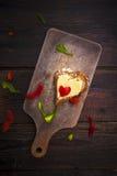 Heart sandwich shape wood board peppers food Stock Photo