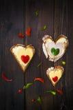 Heart sandwich shape wood board peppers food royalty free stock photo