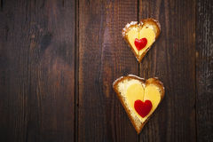 Heart sandwich shape wood board peppers food royalty free stock image