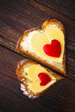 Heart sandwich shape wood board peppers food Stock Image