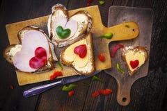 Heart sandwich shape wood board peppers food knife royalty free stock photos