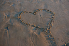 Heart on sandy beach Royalty Free Stock Images