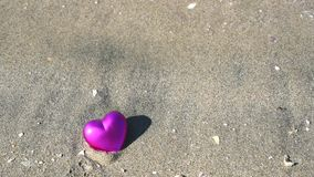 Heart on sandy beach stock video
