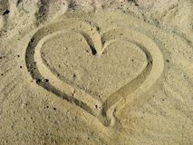 Heart on sandy surface Stock Photo