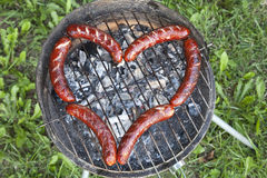 Heart with sausage Stock Photos