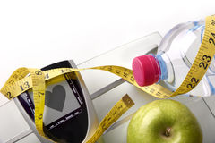 Heart scale with bottle apple and tape measure top Stock Photo