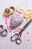 Heart and scrapbooking elements on wooden background Stock Photos