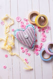 Heart and scrapbooking elements on wooden background Royalty Free Stock Photography