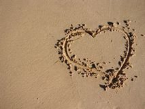 Heart scratched into the sand Royalty Free Stock Photography