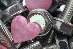 Heart in screws Royalty Free Stock Images