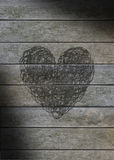 Heart scribbled on a gray weathered wood Stock Images