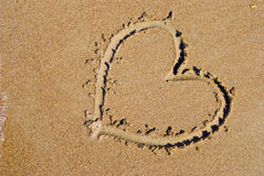 Heart on sea beach royalty free stock images