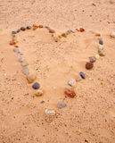 Heart of sea stones on sand Royalty Free Stock Images