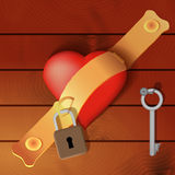 Heart secured by a hasp with wooden background Royalty Free Stock Photo