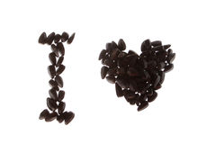 Sunflower and heart. Black sunflower seeds Laid heart Stock Image