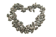 Heart of the seeds on white. Heart of the sunflower seeds closeup on white Royalty Free Stock Photography