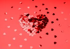 Heart of sequins on a coral background. 14 February stock photos