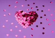 Heart of sequins on a lilac background. 14 February stock image