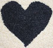 Heart of sesame seeds Royalty Free Stock Photos