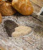 Heart of sesame seeds with bread buns. Close up royalty free stock photography