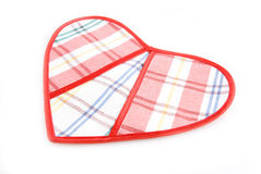 Heart sewn from fabric in cell. On a white background Royalty Free Stock Images