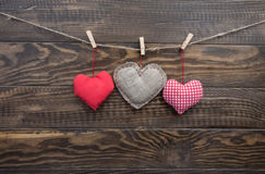 Heart sewn from fabric hanging ropes clothespins Stock Images
