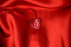 Heart. Shades of red, red heart on a ribbon on a red background Royalty Free Stock Images