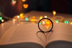 Heart shadow on book Stock Photos